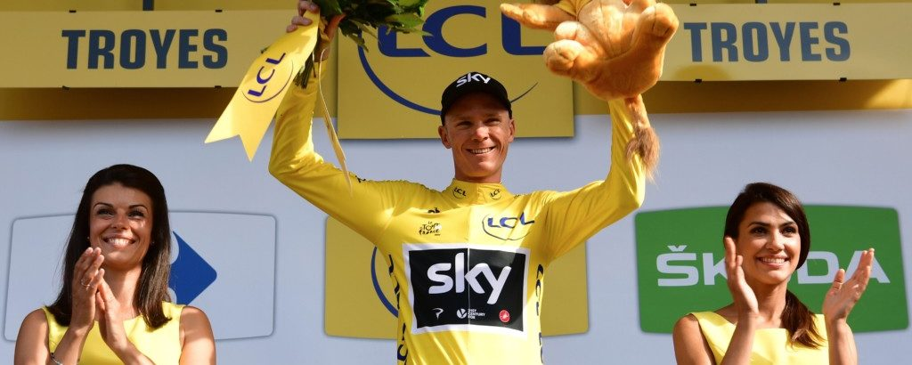 Great Britain's Christopher Froome celebrates his overall leader yellow jersey on the podium at the end of the 216 km sixth stage of the 104th edition of the Tour de France cycling race on July 6, 2017 between Vesoul and Troyes. / AFP PHOTO / PHILIPPE LOPEZ        (Photo credit should read PHILIPPE LOPEZ/AFP/Getty Images)